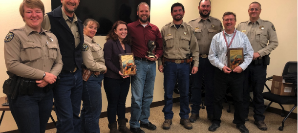 From left, Natalie Renneker, CPW district wildlife manager/Montrose-West; Renzo DelPiccolo, CPW area wildlife manager; Kelly Crane, CPW district wildlife manager, Ridgway; Deputy District Attorney Aubrey Vila; Deputy District Attorney Jason Wilson; Garett Watson, CPW game damage/commercial parks manager; Matt Ortega, CPW district wildlife manager/Montrose-East; District Attorney Dan Hotsenpiller and Mark Richman, CPW district wildlife manager, Delta. The state wildlife agency recently recognized the District Attorney's Office for its prosecution of wildlife violations. (Submitted photo)